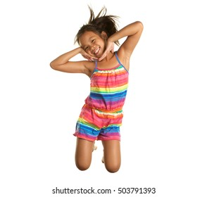 Cute Happy Filipino Girl Jumping on a White Background.