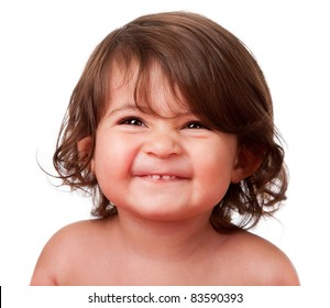 Cute happy funny baby toddler face smiling showing teeth, isolated.
