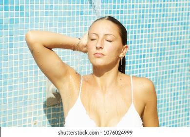 Cute happy girl taking shower