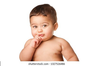 Cute happy innocent baby infant face with big light green eyes and finger in mouth, childhood concept, on white.