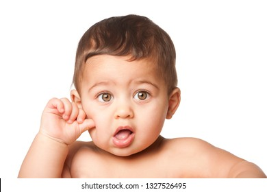 Cute happy innocent baby infant face with big light green eyes and hand thumb on cheek, childhood concept, on white.
