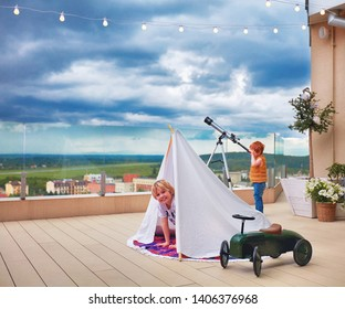 cute happy kids playing games on the rooftop patio
