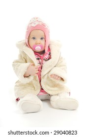 cute happy little baby with winter hat and coat isolated on white