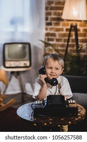 cute happy little boy talking by telephone, 1950s style