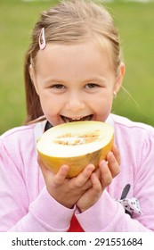 cute happy little girl with melon