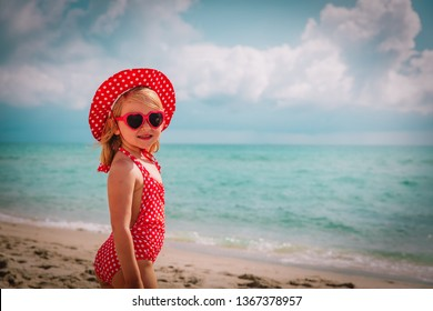 cute happy little girl with sunglasses on beach vacation