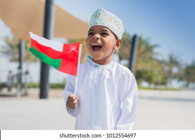 Cute happy Omani boy wearing dish dasha