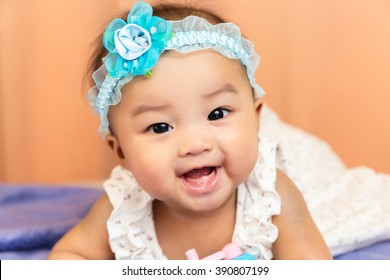 Cute happy smiling Asian baby with teeth from birth