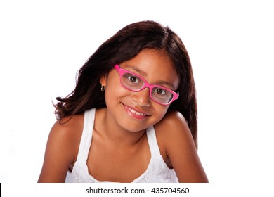 Cute happy smiling Latina Hispanic girl with pink glasses, on white background.