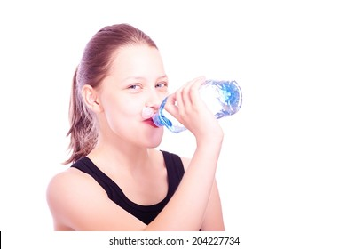 Cute happy teen girl drinking water from bottle after exercises