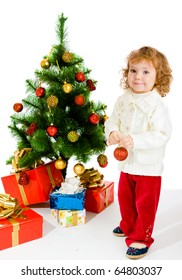 Cute happy toddler decorating Christmas tree