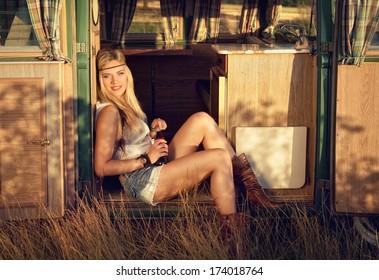 cute hippie girl on an old minibus