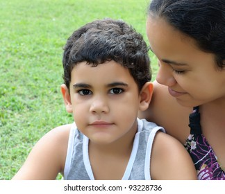 Cute hispanic boy and his beautiful young mother