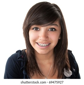 Cute Hispanic teenage girl smiling with braces on a white background
