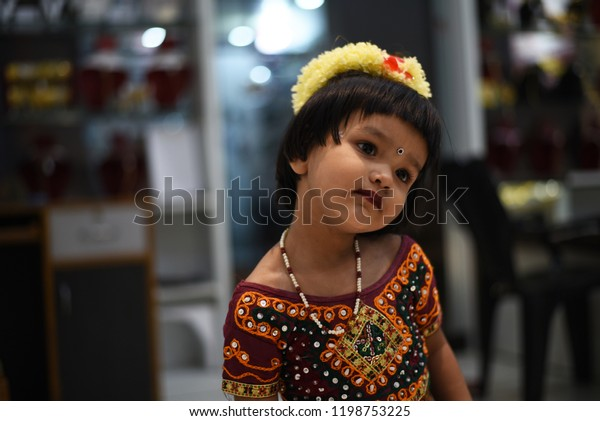 0849f64285 Cute Indian baby girl dresses in traditional clothes and giving some  natural poses.