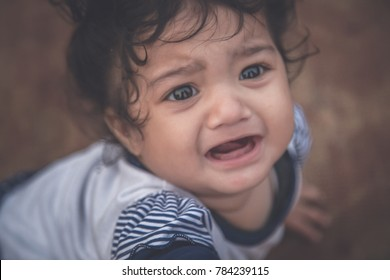 Cute Indian baby kid girl crying
