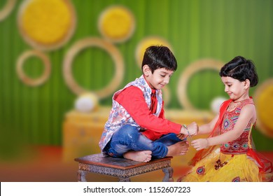 cute Indian brother and sister celebrating raksha bandhan festival