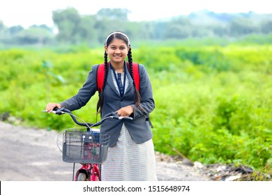 Cute Indian College girl with cycle