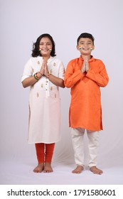 Cute Indian kids with Folded Hands Representing Traditional Indian Greeting, Namaste on White background.