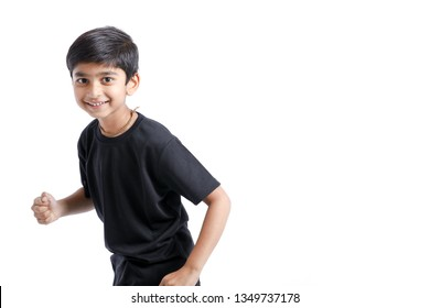 Cute Indian little boy playing , running and giving multiple expression