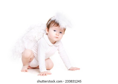 Cute infant angel with wings isolated on white. beautiful little girl dressed as an angel. valentine's day. baby girl with angel wings. Smiling infant baby with angel wings and nimbus