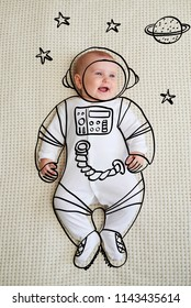Cute infant baby girl sketched as astronaut
