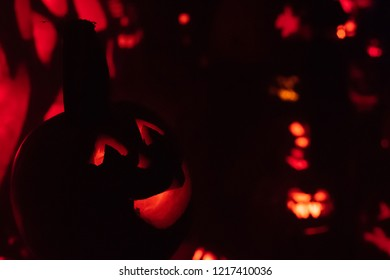 Cute jack-o-lantern in foreground of holiday decorations