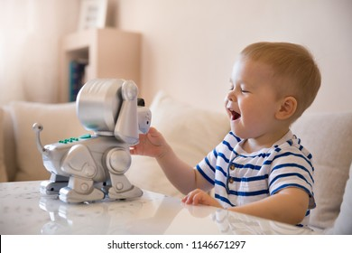 Cute kid boy playing with interactive toy. Child with toy robot dog. Activities for small children. Communication and digital concept.