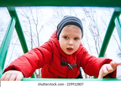 Cute kid climbing upstairs on playground