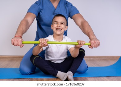 Cute kid with disability has musculoskeletal therapy by doing exercises in the hospital