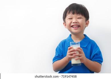 Cute kid drinking milk on white background