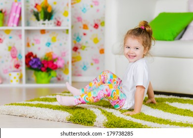 Cute kid girl playing in the room