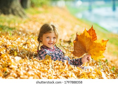 Cute kid girl woman in autumn park. Leaves falling. Autumn child mood - Shutterstock ID 1797888358