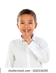 Cute kid has put forefinger to lips as sign of silence, isolated on a white background