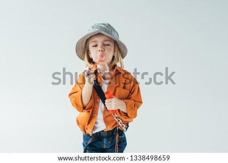 c24b0194 Cute Kid Hat Orange Shirt Blowing Stock Photo (Edit Now) 1338498659 ...