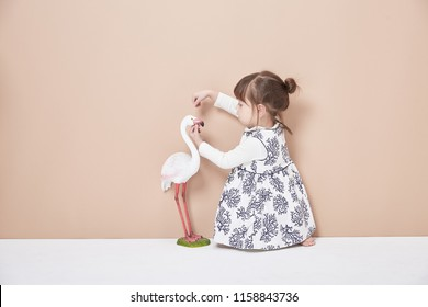 Cute kid playing doctor with egret isolated
