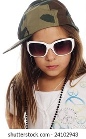 Cute kid playing dress up wearing army cap and sunglasses