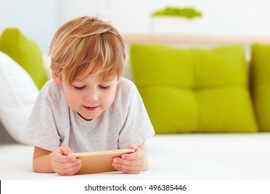 cute kid playing games on smartphone
