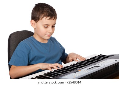 Cute kid playing piano, isolated on white background