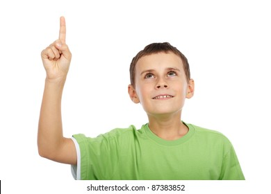 Cute kid pointing up, isolated on white background