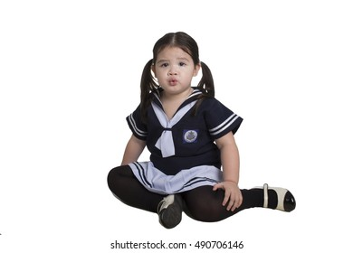 Cute kid in Sailor costume on white background