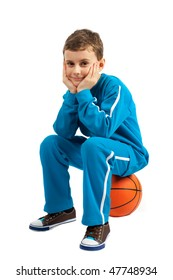 Cute kid sitting on a basket ball isolated on white