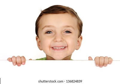 Cute kid smiling and holding a banner on white with copy space