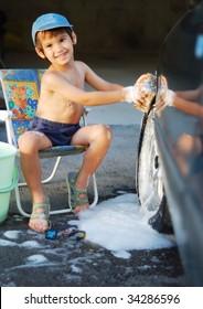 Cute kid washing car