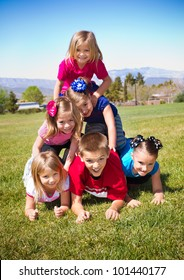 Cute Kids Building a Human Pyramid outdoors