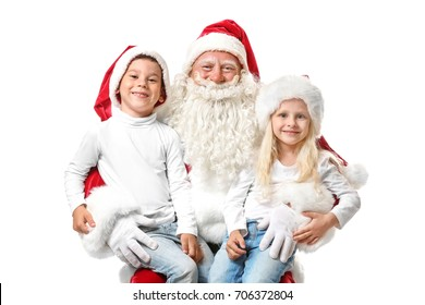Cute kids in Christmas hats and authentic Santa Claus on white background