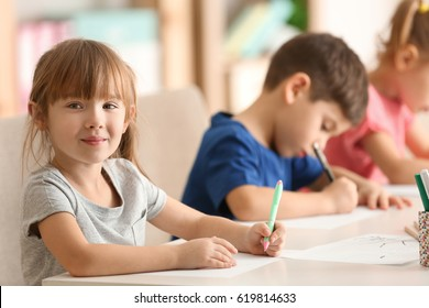 Cute kids drawing in classroom