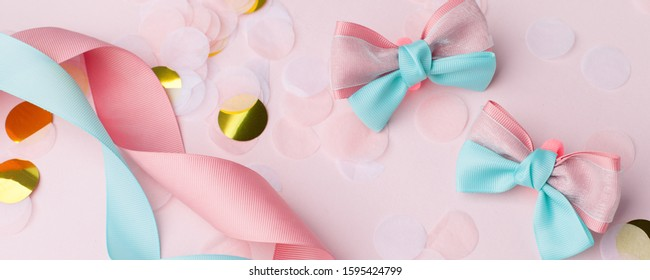 Cute kids hair claws on pink background. Hair clips, hairpins, bow tie for holiday party. Fashion design hair accessories for little girls, decor for hair, childhood concept, banner
