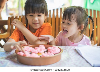 Cute kids have dessert on a party buffet – cupcakes with breakfast.