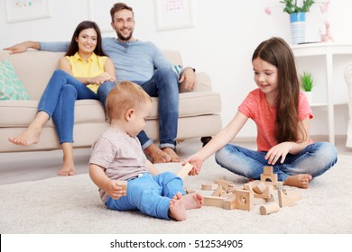 Cute kids playing games at home